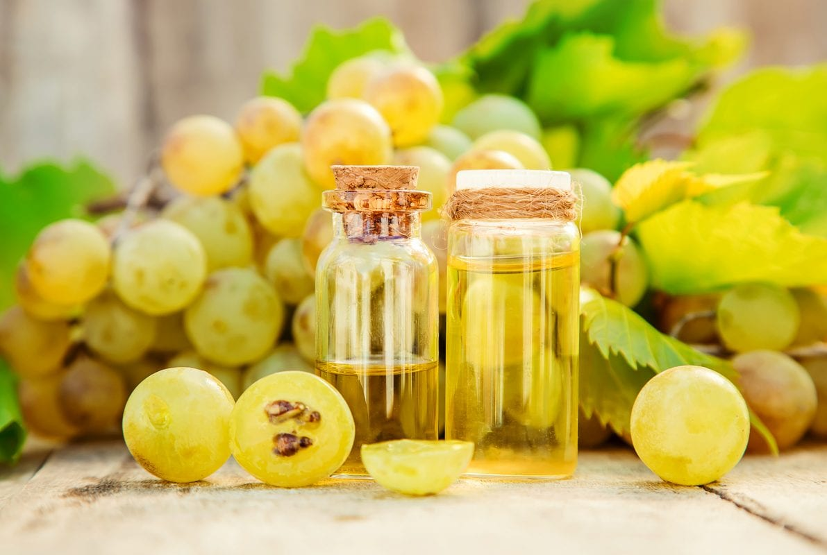 grape seed oil in a small jar. Selective focus. nature.